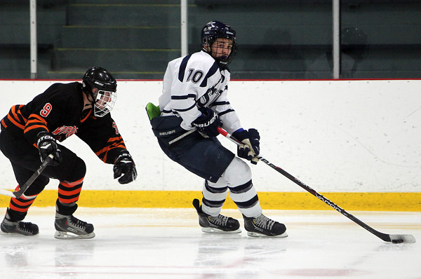 St. John's Prep senior Cam Shaheen looks to center the puck after blowing bye Woburn's Brian Elliot, on Saturday afternoon. Shaheen scored one of the Prep's 4 goals as they defeated Woburn 4-2 at Ristuccia Arena in Wilmington. David Le/Staff Photo