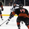 St. John's Prep junior forward Jack McCarthy lines up a shot on net against Woburn on Saturday afternoon. David Le/Staff Photo