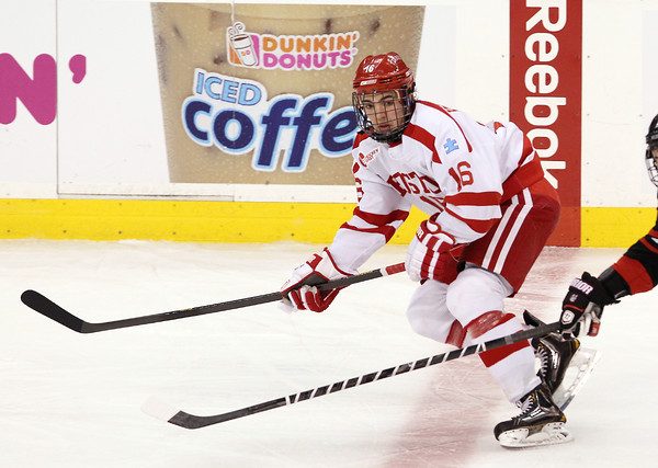 Boston: Boston University freshman winger Sam Kurker keeps his eyes on the puck as he flies into the offensive zone against Northeastern in the opening game of the Beanpot Tournament. David Le/Salem News