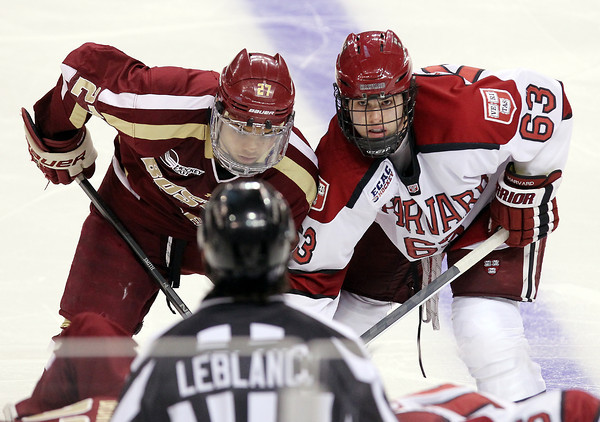 Boston: Harvard sophomore forward Colin Blackwell jostles with Boston College forward Quinn Smith, left, in the face-off circle in the second period of play on Monday night. David Le/Salem News