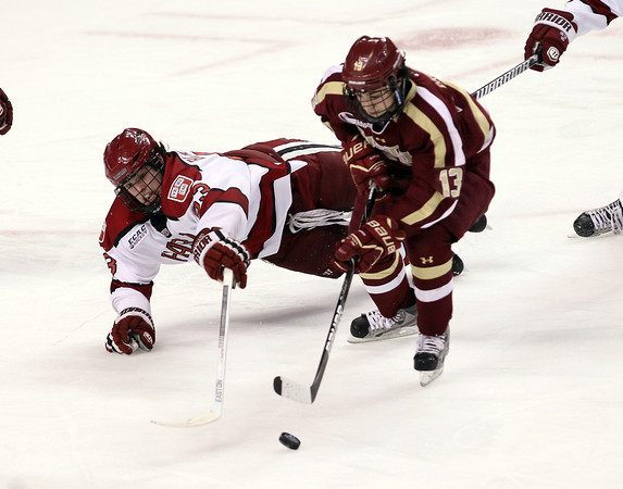 Boston: Harvard sophomore forward Colin Blackwell, left, makes a diving attempt to poke the puck away from Boston College forward Johnny Gaudreau during the first period of play on Monday evening. David Le/Salem News