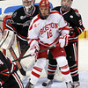 Boston: Boston University freshman forward Sam Kurker, center, jostles for position with Northeastern goalie Chris Rawlings, left, and defenseman Colton Saucerman, right, during the second period of play. David Le/Salem News