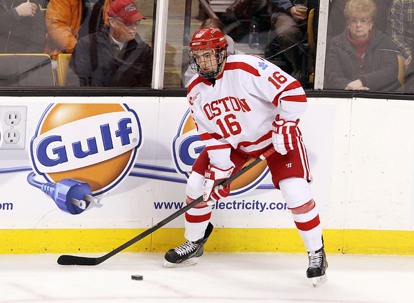 Boston: Former St. John's Prep star and Boston University freshman winger Sam Kurker controls the puck along the boards in the second period of play on Monday afternoon. David Le/Salem News
