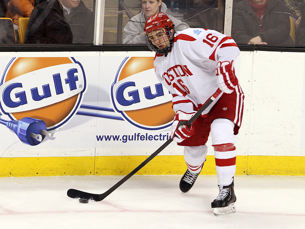 Boston: Boston University freshman winger Sam Kurker slings a pass across ice to a teammate during the second period of play on Monday afternoon. The Terriers fell to the Northeastern Huskies 3-2 in the Beanpot. David Le/Salem News