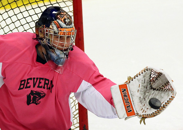 Salem: Beverly sophomore goalie Tim Biarelli concentrates and makes a glove save on a shot ripped off by Danvers senior Adam Merry in the second period of play on Wednesday evening. Biarelli made 30 saves for the Panthers as they took down the Falcons 4-2 on Pink the Rink night at Salem State. David Le/Salem News