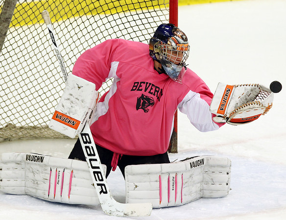 Salem: Beverly sophomore goalie Tim Biarelli keeps his eyes on the puck while making a glove save against Danvers on Wednesday evening. In a battle of the top two teams in the NEC North, the Panthers took down the Falcons 4-2 at Salem State University on Wednesday evening. David Le/Salem News
