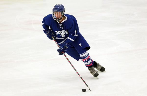 Salem: Danvers High School junior winger Matt Flynn carries the puck up-ice against Beverly on Wednesday evening. David Le/Salem News