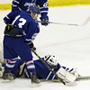 Salem: Danvers sophomore goalie Alex Taylor dives forward to pounce on a loose puck in front of the Falcons net. David Le/Salem News
