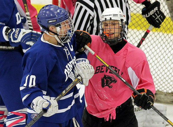 Salem: Danvers senior captain Joe Strangie, left, and Beverly junior captain Connor Irving exchange a few words in between face-offs during the second period of play on Wednesday evening. David Le/Salem News