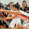 Beverly: Beverly junior forward Jonathan Berchoff pulls in an offensive rebound against Lynn Classical on Friday evening. David Le/Salem News