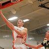 Beverly: Beverly junior forward Zach Duguid glides in for an easy layup against Lynn Classical on Friday evening. David Le/Salem News