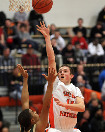 Beverly: Beverly High School junior forward Craig Hall releases a floater in the lane against Lynn Classical on Friday evening. David Le/Salem News