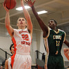 Beverly: Beverly junior forward Zach Duguid, left, puts a layup off the glass ahead of the block from Lynn Classical sophomore Phillip Rogers, right, on Friday evening. David Le/Salem News