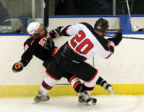 Salem: Marblehead senior captain Ty Bates checks Beverly forward Ted Leathersich hard into the boards during the second period of play on Friday evening. David Le/Salem News