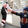 Salem: Three-year-old Nolan Topp, of Salem, awaits high fives from Marblehead players as they take the ice while dressed as Captain America prior to the start of the Marblehead-Beverly hockey game on Friday evening. David Le/Salem News