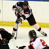 Salem: Marblehead junior defenseman Liam Gillis fires a centering pass across ice against Beverly. David Le/Salem News