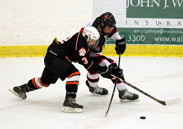 Salem: Beverly junior forward Kevin Lally, left, and Marblehead senior defenseman Cam Rowe lock up as they battle for control of the puck during the first period of play on Friday evening. David Le/Salem News