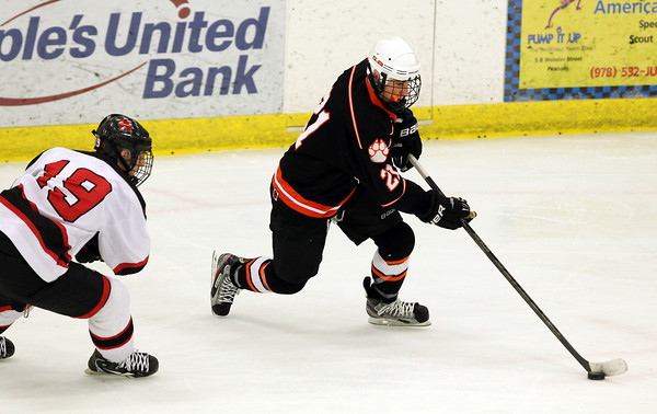 Salem: Beverly High School junior Graham Doherty walks into the offensive zone with the puck while being chased by Marblehead junior Erik Powers, left, on Friday evening. David Le/Salem News