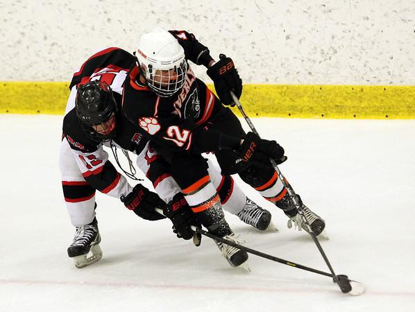 Salem: Marblehead junior forward Erik Powers and Beverly junior defenseman Jack Morency get tangled up as they battle for a puck on Friday evening. David Le/Salem News