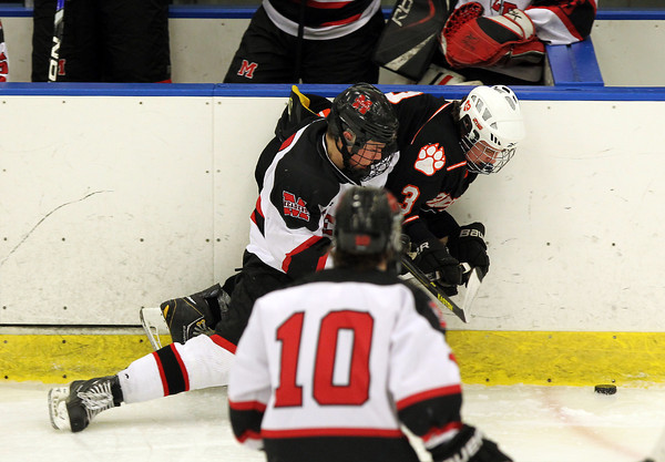 Salem: Marblehead senior defenseman Cam Rowe rides Beverly junior forward Kevin Lally into the boards as they fight for the puck. David Le/Salem News