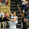 Danvers: Danvers senior Nick McKenna soars in for two points ahead of a block attempt from Greater Lawrence's Oscarlin Renoso. McKenna led the Falcons to a 78-41 win over Reggies with 24 points on Wednesday evening. David Le/Salem News