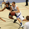 Danvers: Danvers senior captain Nick McKenna, right, drives past Greater Lawrence's Cristian Rivera during the third quarter of play on Wednesday evening. McKenna paced the Falcons with 24 points to guide Danvers to a 78-41 win. David Le/Salem News
