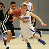 Danvers: Danvers senior Jake Cawlina, right, chases down Greater Lawrence's Frankely Estrella, left, and pressures the ball. David Le/Salem News