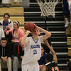 Danvers: Danvers sophomore Vinny Clifford hits a three-pointer from the corner right at the buzzer to extend the Falcons lead over Greater Lawrence. David Le/Salem News