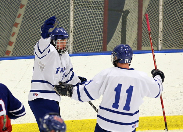 Salem: Danvers High School senior winger Adam Merry celebrates his second goal of the game with junior teammate Jay Calcagno, right, during the third period of play on Tuesday evening. Merry scored two goals to help the Falcons sail past Somerville in the first round of the D2 playoffs.  David Le/Salem News