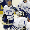 Salem: Danvers senior captain Rob Buchanan, left, greets sophomore goalie Alex Taylor with a fist bump after the Falcons downed Somerville 9-1 on Tuesday evening. David Le/Salem News