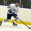 Salem: Danvers High School junior defenseman Ryan Cassidy looks to pass the puck against Somerville on Tuesday evening. David Le/Salem News