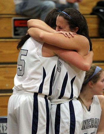 Hamilton: Hamilton-Wenham senior captains Taylor Morong, right, and Cassandra Fibbe, tearfully hug after the Generals fell to the Watertown Raiders 42-37 on Thursday evening in the D3 Girl's State Tournament. David Le/Salem News