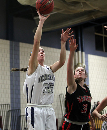 Hamilton: Hamilton-Wenham junior center Sam Charette, left, shoots a jumper over Watertown freshman Katelyn Rourke. David Le/Salem News