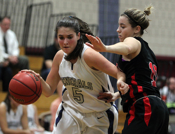 Hamilton: Hamilton-Wenham senior Cassandra Fibbe tries  to drive past Watertown junior Gabriella Coppola during the first quarter of play on Thursday evening. Fibbe and the Generals couldn't get past the Raiders, falling 42-37 in D3 girl's tournament play. David Le/Salem News