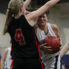 Hamilton: Hamilton-Wenham senior captain Cassandra Fibbe, right, runs into Watertown sophomore Rachel Morris during the second half of play. Fibbe and the Generals couldn't manage to get past the Raiders, falling 42-37 on Thursday evening. David Le/Salem News