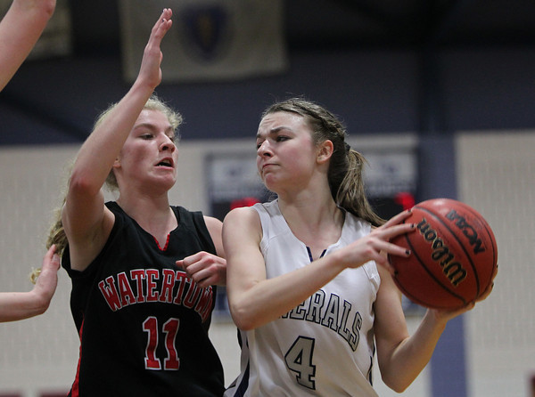 Hamilton: Hamilton-Wenham junior guard Haley Willis, right, looks to pass around Watertown sophomore Rachel Campbell, on Thursday evening. David Le/Salem News