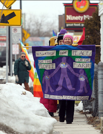 Salem: Clare Ritchie, of the Salem Peace Committee, leads the annual Walk for Peace along Bridge St. in Salem on Tuesday afternoon. David Le/Salem News