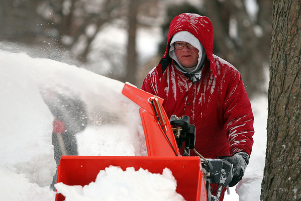 Swampscott: Charlie Donoghue, of Swampscott uses a snowblower to cut a path along the sidewalk in front of his house on Saturday afternoon as the cleanup from Winter Storm Nemo began. David Le/Salem News