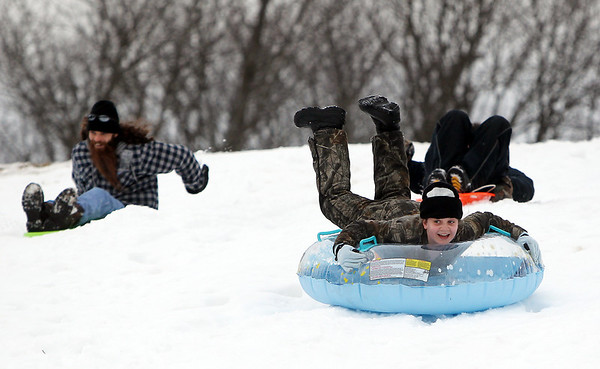 Salem: Jasmine Potorski, 11, of Salem, races down a hill on a snow tube at the Kernwood Country Club on Tuesday afternoon. David Le/Salem News