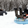 Salem: Jasmine Potorski, 11, of Salem, races down a hill on a snow tube at the Kernwood Country Club on Tuesday afternoon. David Le/Salem News