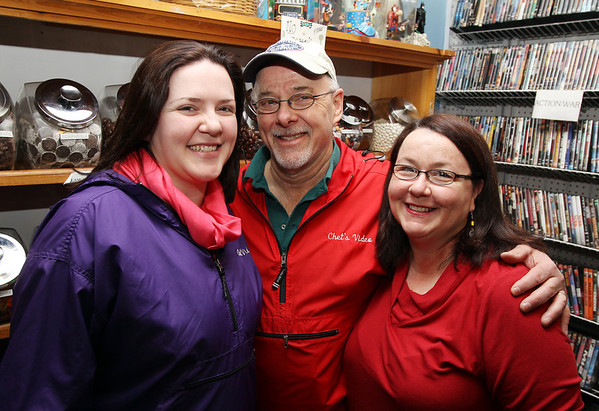 Marblehead: Chet Strout, center, owner of Chet's Video and Candy Shoppe, with his wife Carrie Thomas, right, and daughter Melissa Strout, left, have been in business for 20 years. Chet's Video is the only video store left on the North Shore. David Le/Salem News