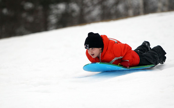 Salem: Casey DeCamp, 7, of Nahant, flies down a snow covered hill while visiting his grandmother in Salem on Tuesday afternoon. David Le/Salem News