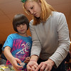 Danvers: Michelle Gettings, of Danvers helps her son Jude, 8, to decorate a crown at the All Saints Episcopal Church's first Shrove Tuesday Pancake and Sausage Supper on Tuesday afternoon. David Le/Salem News