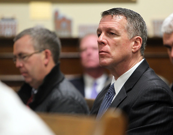 Beverly: Beverly Police Chief Mark Ray listens to Beverly Mayor Bill Scanlon's State of the City address in the City Council Chambers on Tuesday evening. David Le/Salem News