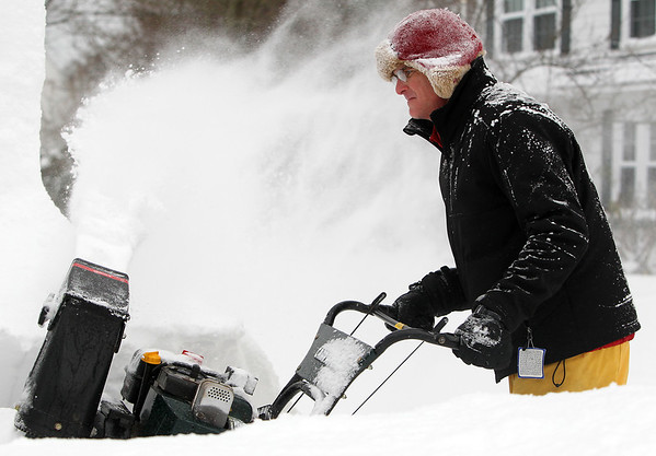 Marblehead: Bill Corbett, of Marblehead is showered in snow while using a snowblower to clear his driveway on Saturday afternoon. David Le/Salem News