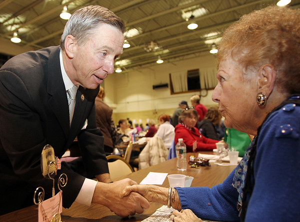 Salem: Congressman Steve Lynch, who is running for US Senate, talks with Irene Sheehan, of Peabody, prior to the start of a Bingo night at St. Peter's Church in Salem. David Le/Salem News