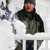 Marblehead: Frank Sgambellone shovels off his porch on Saturday afternoon in the aftermath of Winter Storm Nemo. David Le/Salem News