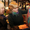 Salem: Carol Wilson, right, an employee at J Mode Fashions in Salem, shows a few new designs to Hope Zabar, of Swampscott, on Friday afternoon. J Mode Fashions will be holding a benefit fashion show, The Art of Dressing: A Cocktail Soiree and Fashion Show, on March 2nd. David Le/Salem News