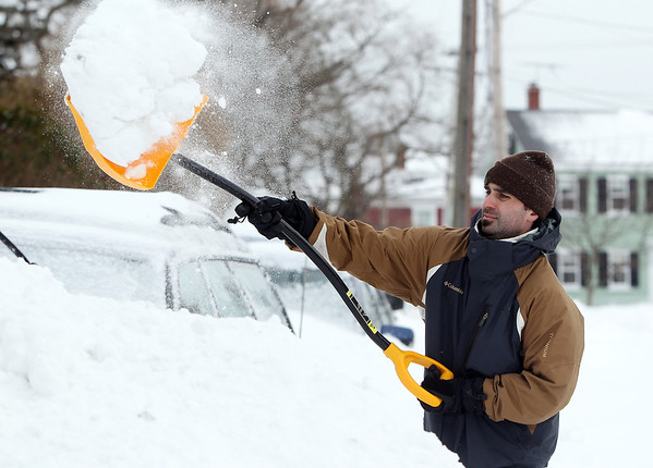 Salem: Ben Galuardi, of Salem shovels out his car which had been covered in snow on Saturday afternoon in the aftermath of Winter Storm Nemo. David Le/Salem News