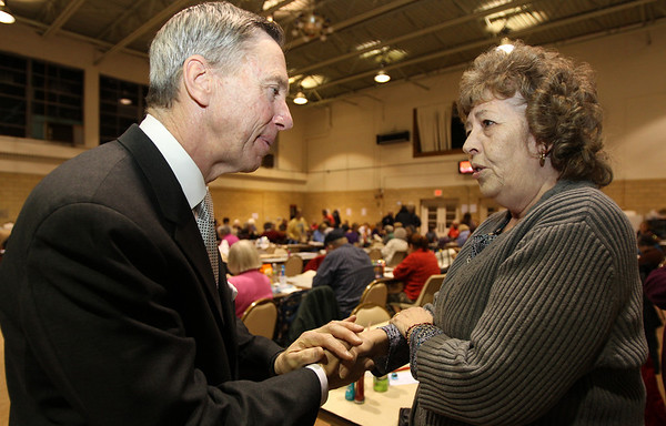 Salem: Congressman Steve Lynch, who is running for US Senate, chats with Marilyn Costa, of Salem, prior to the start of a Bingo night at St. Peter's Church in Salem. David Le/Salem News